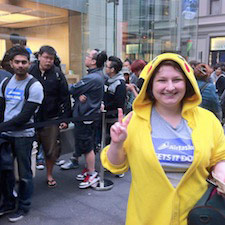 Happy Airtasker worker wearing a Pikachu costume and doing the peace sign at an Apple Store event