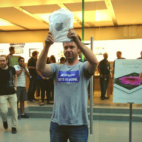 Man lines up at the apple store for a product release
